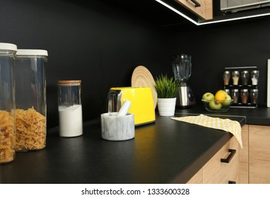 Stylish kitchen counter with houseware, appliances and products