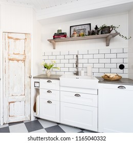 stylish kitchen detail with sink and old door