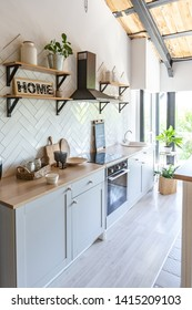 stylish kitchen interior design. white walls and wooden decoration. beautiful hammock and high windows.