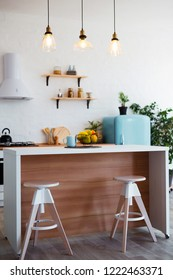 Stylish kitchen interior with dining table and chairs.
