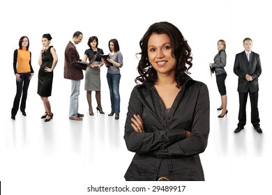 Stylish lady leader of a large group of business people  - all in focus - at a stuff meeting  isolated on white background