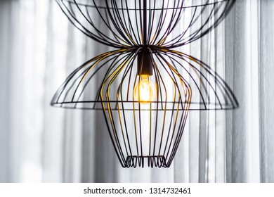 Stylish lamp. Interior of a modern apartment.