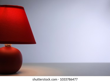 Stylish lamp on table against color background