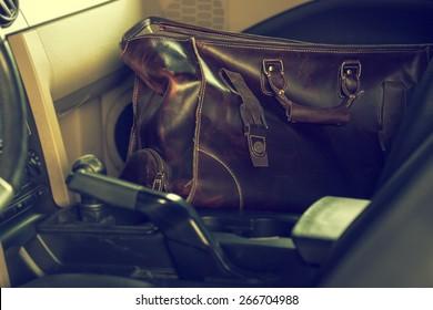 stylish leather bag inside the car