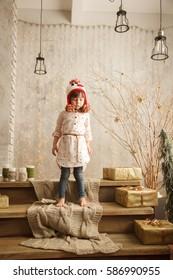 Stylish little girl in light pink dress