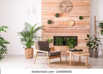 Stylish living room interior with armchair, green plants and miniature zen garden. Home design ideas - Shutterstock ID 1564064455
