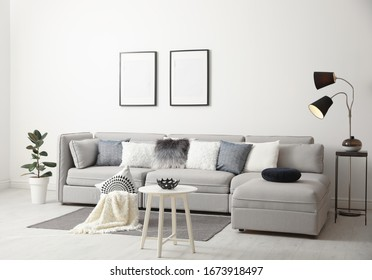 Stylish living room interior with comfortable sofa