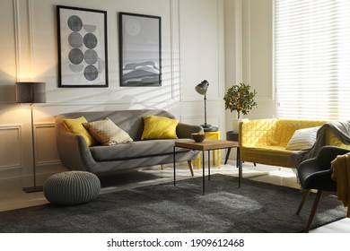 Stylish living room with sofas. Interior design in grey and yellow colors