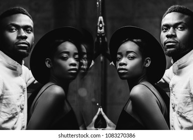 stylish Lovely african newlyweds posing at big mirror in hotel room. mirror reflection