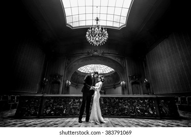 stylish luxury bride and handsome elegant groom dancing on the background of old wooden  luxury interior