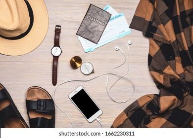 Stylish male clothes with accessories, mobile phone, passport and tickets on wooden background