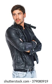 Stylish man with arms crossed in a leather jacket looking away. Isolated on a white background