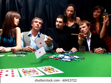 Stylish man in black suit folds two cards in casino poker at Las Vegas over black