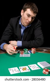 Stylish man in doubt before making bet in the casino
