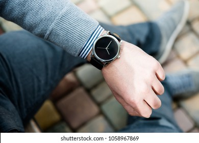 Stylish man in gray jumper, elegant business man's hand with fas