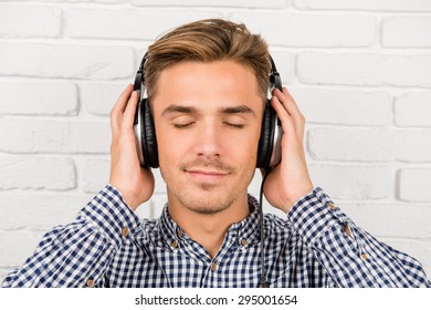 stylish man listening to music on headphones