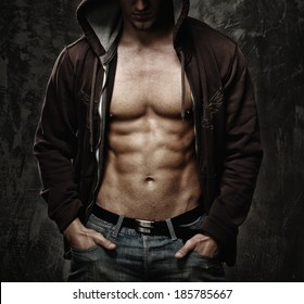 Stylish man with muscular torso wearing hoodie