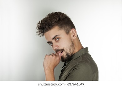 stylish man with a mustache and beard  lost in thought