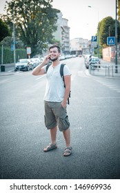 stylish man on the phone at the street