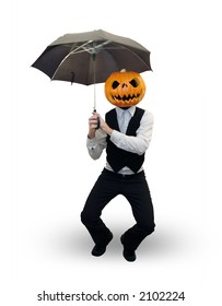 Stylish man with a pumpkin head holds an umbrella