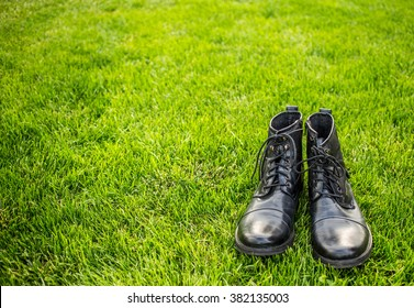 Stylish man shoes on green grass