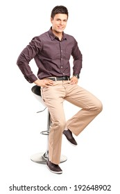 Stylish man sitting on a modern chair isolated on white background