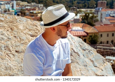 stylish man smiles away on the street