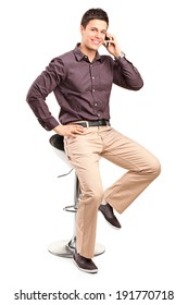 Stylish man talking on a cell phone isolated on white background