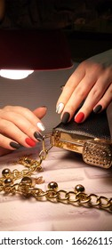 stylish manicure design combined black and red color gel polish geometry leaflets thin lines photo with a cool fashion handbag gold chain