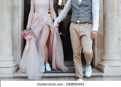 Stylish marriage couple get out of the church together. Wedding clothes. Wedding idea.