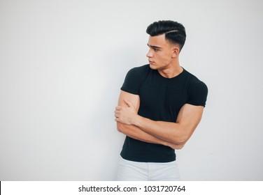 stylish mens athletic black t-shirt on white background, fashion men