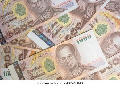 Stylish men's purse with money on wood background
