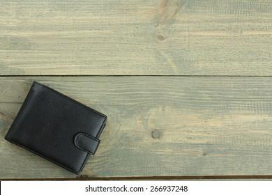 Stylish men's purse on wood background