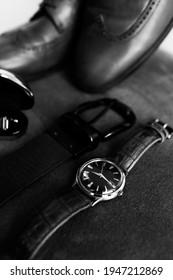 Stylish men's watch and belt - Shutterstock ID 1947212869