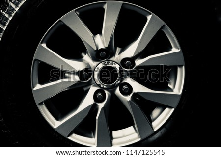 Stylish metallic alloy wheel of a car isolated unique photograph