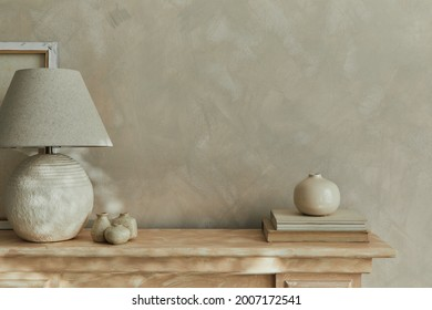 Stylish minimalistic monochromatic composition with design vases, elegant lamp and personal accessories. Copy space. Neutral colors. Template.