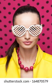 Stylish model posing in colorful wear and accessories. Shutter Shade sunglasses