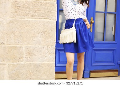 Stylish model in summer clothes. Summer wardrobe. Fashion model. Marine style. Space for text. Street style look. Indigo color. City fashion. Outfit. Summer fashion look.