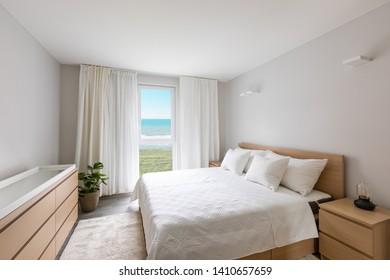Stylish modern bedroom. No one inside