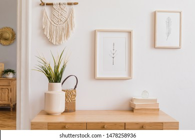 Stylish and modern boho interior of living room with mock up photo frames, flowers in vase, wooden desk, beige macrame and elegant accessories. Design home decor. Bohemian concept. Mockup ready to use - Shutterstock ID 1478258936