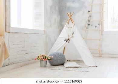 Stylish modern children room. Kid's wigwam in children room