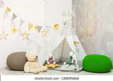 Stylish modern children room. Kid's wigwam in children room. wooden star lamp. Interior scandinavian style.