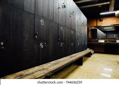 Stylish modern comfortable spacious locker room. Interior, nobody. Expensive quality materials, luxury. Loft design dressing room.