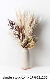 Stylish modern dried flower arrangement in a cream and pink vase. Including Banksia, pampas grass, bulrush and ruscus leaves. Art decoBoho gift for Anniversary, birthday, mothers day. - Shutterstock ID 1798821208