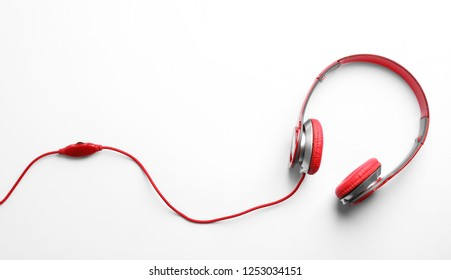 Stylish modern headphones with earmuffs on white background, top view. Space for text