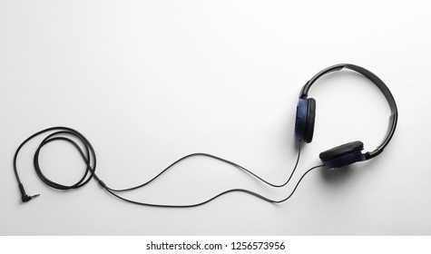 Stylish modern headphones with earmuffs on white background, top view