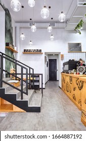 Stylish. Modern interior of cafe.Authentic style with element of loft.Metal and wooden detail. Green, orange,white and grey colors