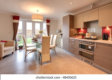 Stylish modern kitchen with table set for dinner within chic home
