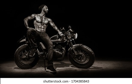 Stylish motorcycle with brutal man rider at night