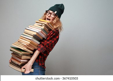 stylish nerd girl with many books
